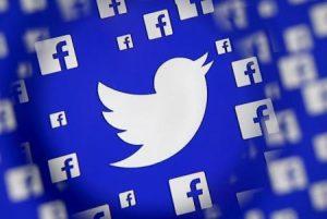 شعارا تويتر وفيسبوك كما ظهرا في استطلاع أجري في سراييفو في جمهورية البوسنة والهرسك يوم 16 ديسمبر كانون الأول 2015. تصوير دادو روفيتش - رويترز.